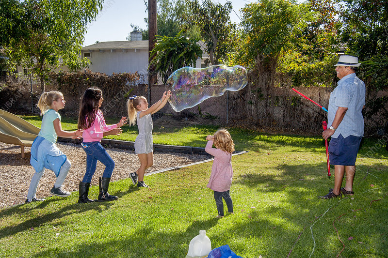 Children play with Giant Bubble