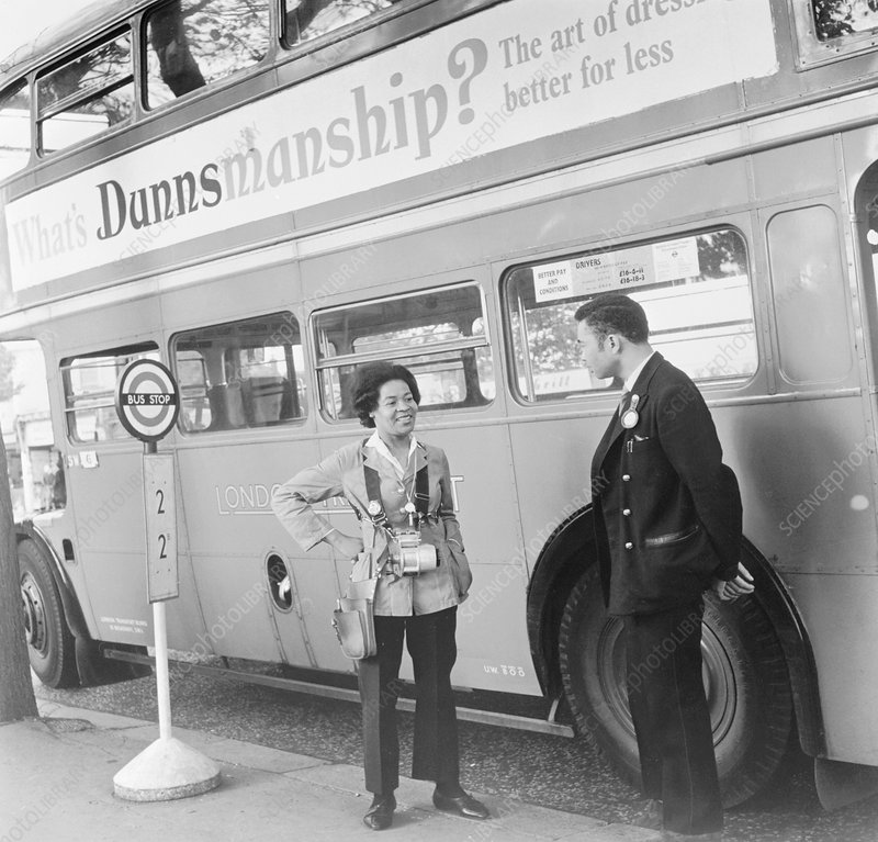 Bus conductress and driver at Crystal Palace, London, 1962