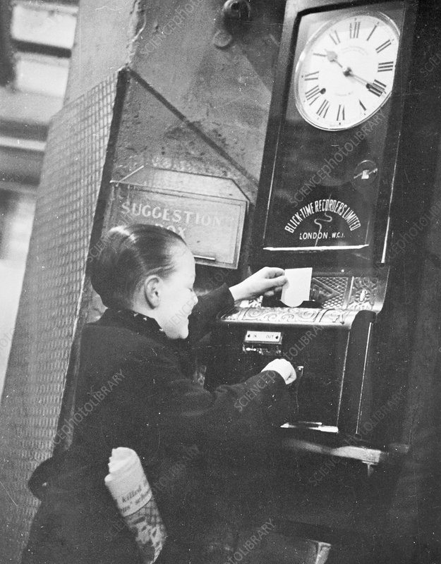 Boy clocking on at the Trocadero Restaurant, London, c1939