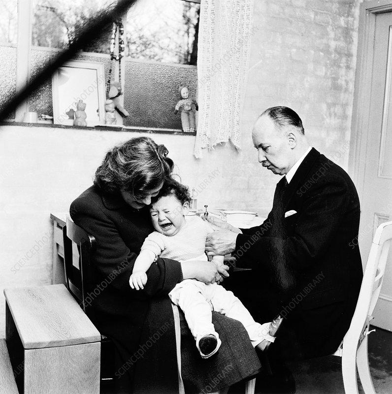 Baby being immunised, London, 1953