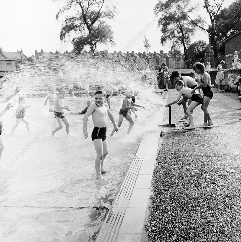 Children playing in a London paddling pool, c1950s