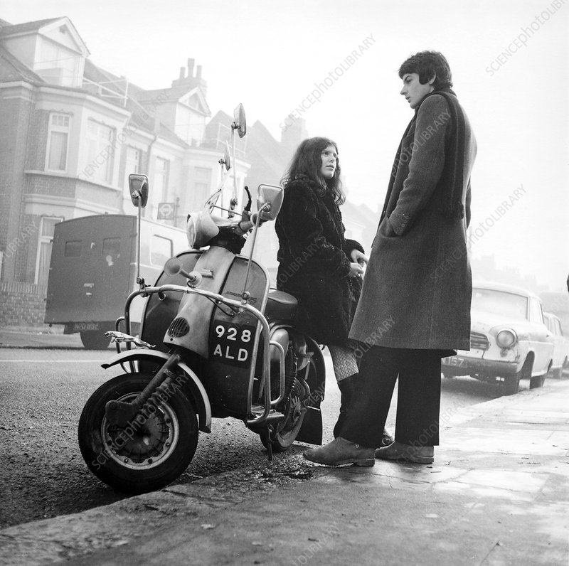 Couple with a scooter, London, 1967