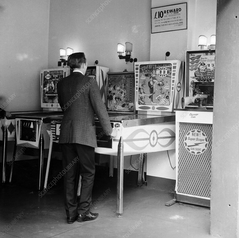Man playing pinball in a London amusement arcade, c1966-67