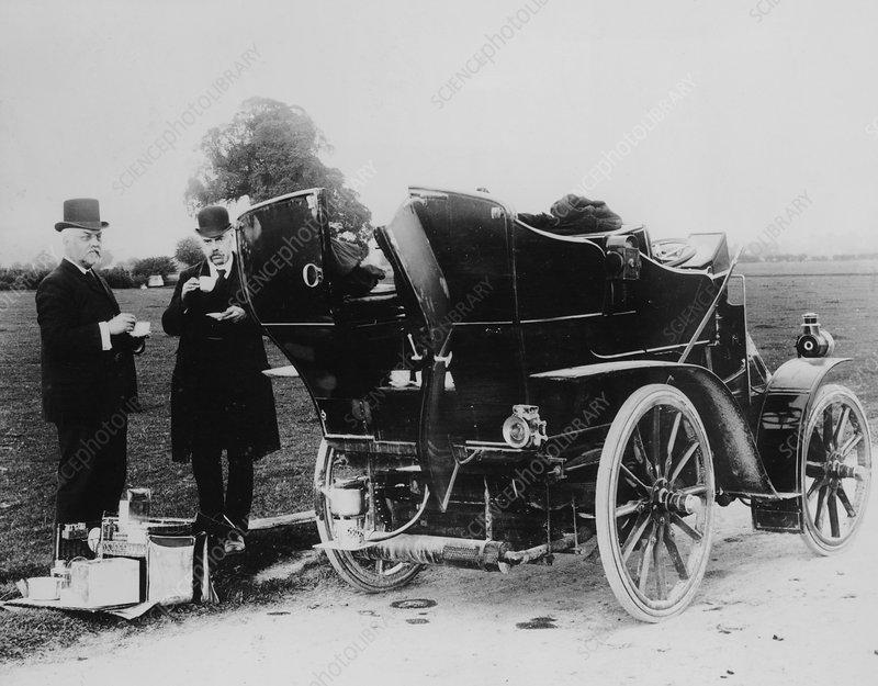 Men having tea beside a 1901 Panhard