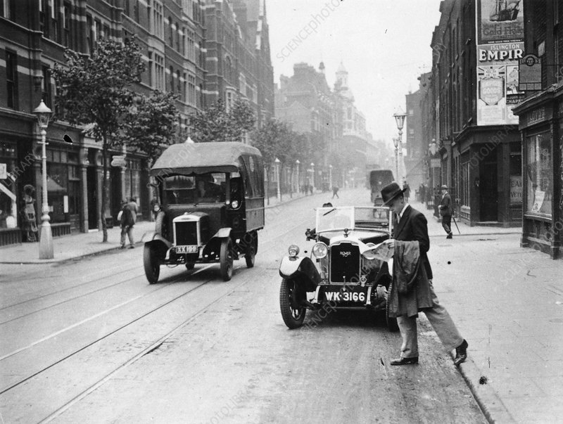 A Rover 1928 sports car parked in a London street, 1931