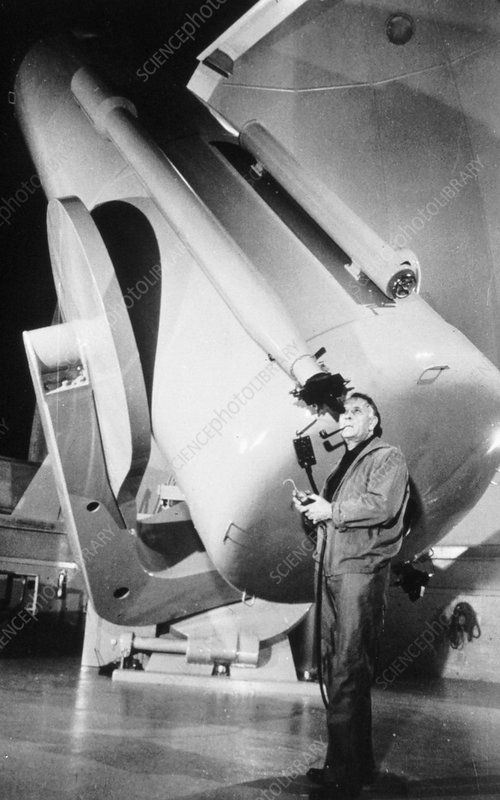 Edwin Powell Hubble, American astronomer, in the observatory
