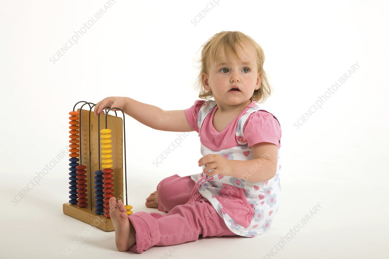 Little girl playing with an abacus