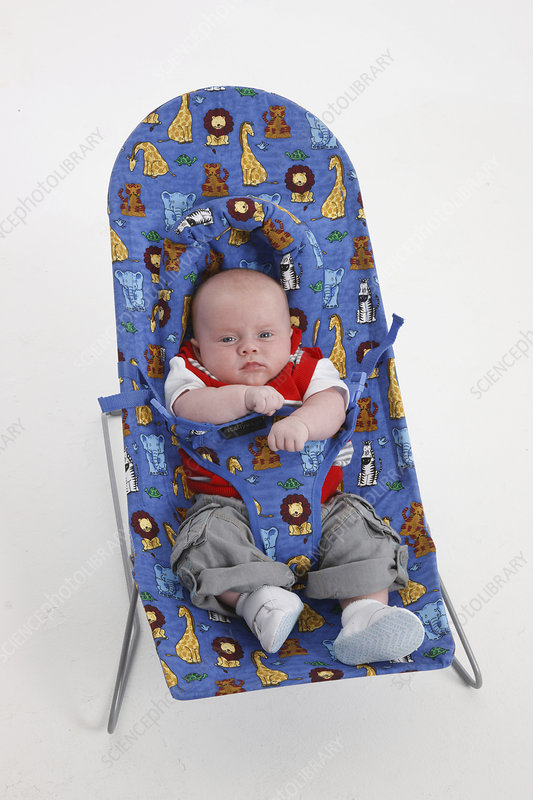 Baby boy in baby bouncer