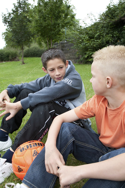 Portrait of boys with football