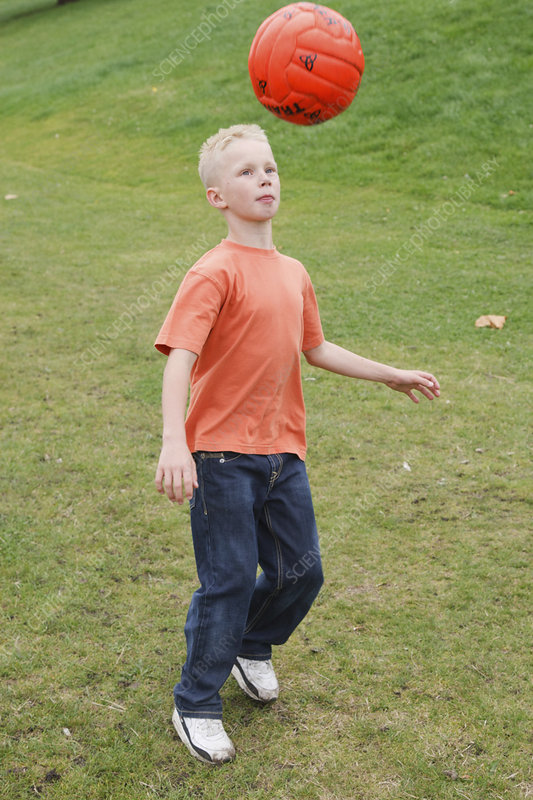 Boy playing with football