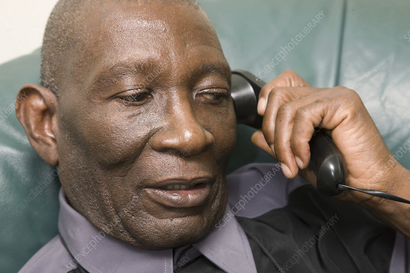 Older man chatting on the telephone