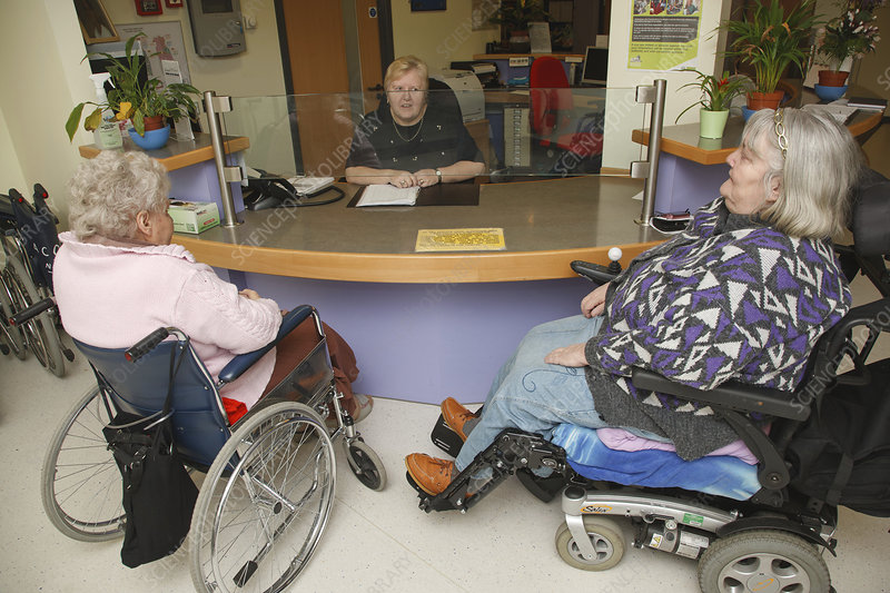 Receptionist with wheelchair users