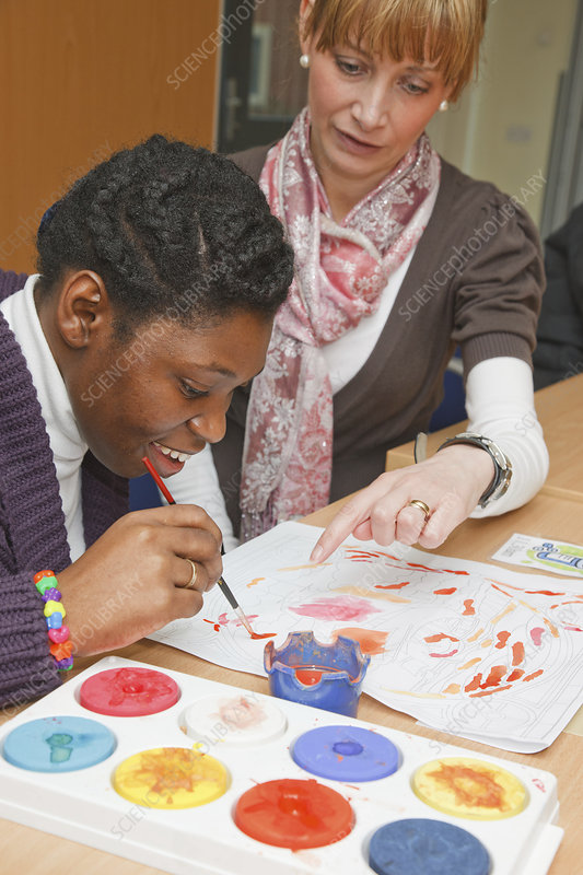 Black girl with cerebral palsy in painting class