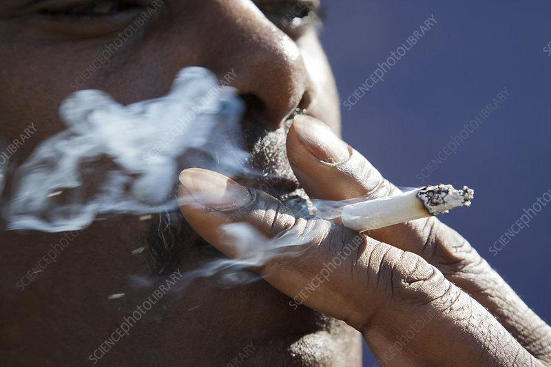 Portrait of black man smoking