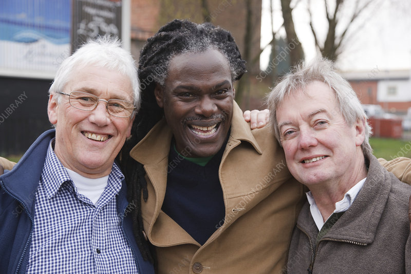 Three men together laughing