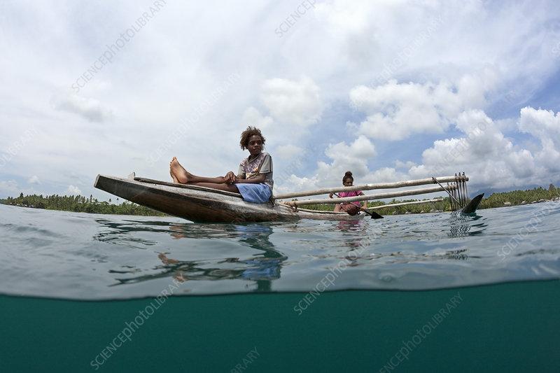 Women in outrigger canoe, Tufi, Papua New Guinea