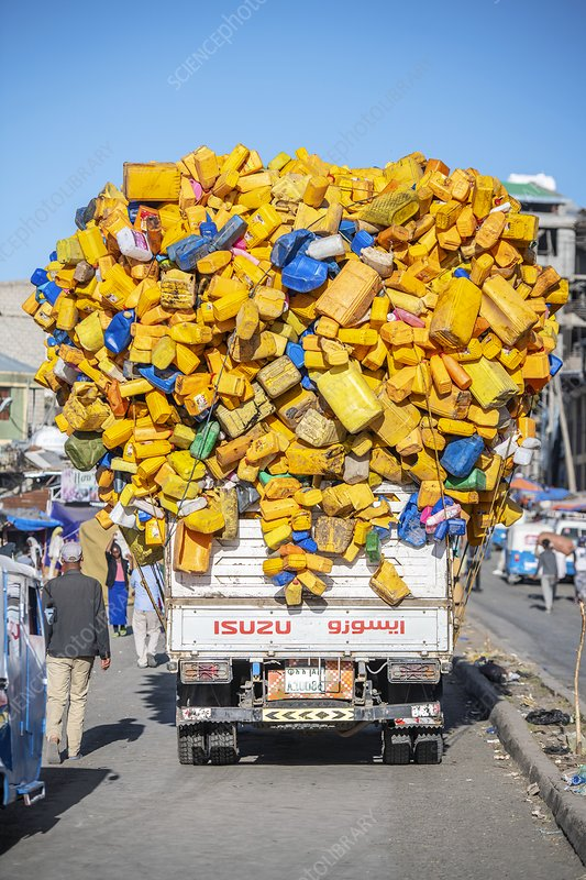 Truck overloaded with plastic containers