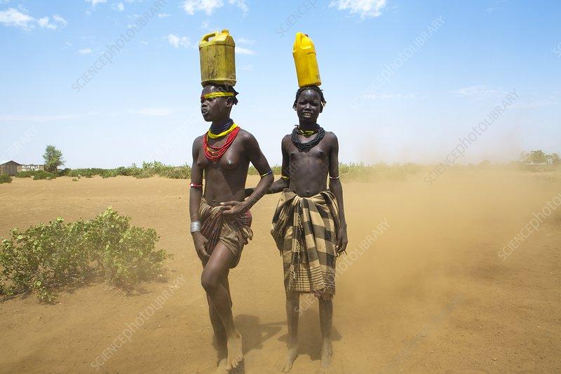 Dasanesh women carrying water, Ethiopia
