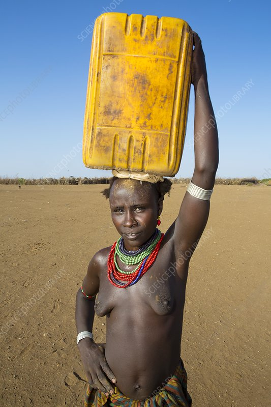 Dasanesh woman carrying water, Ethiopia