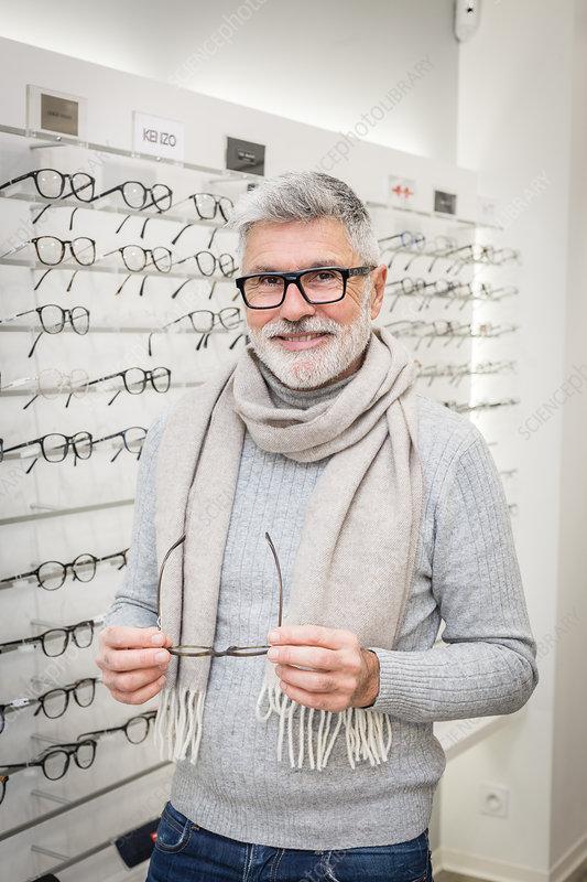 Man trying prescription glasses