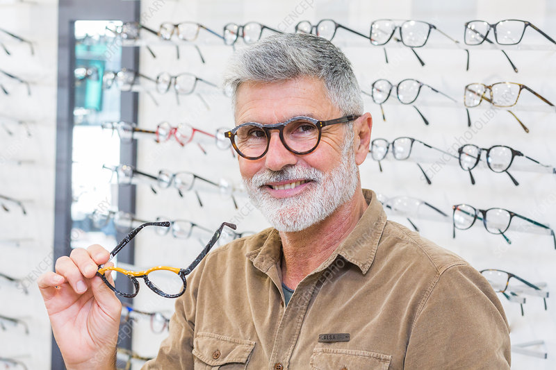 Man trying prescription glasses