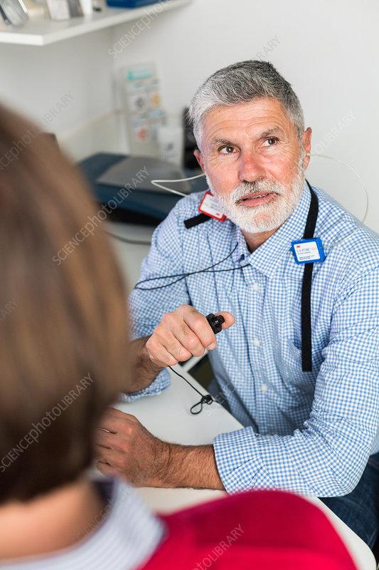 Man undergoing pure-tone audiometry test