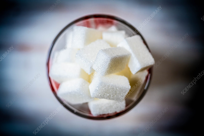 White sugar cubes in a measuring cup