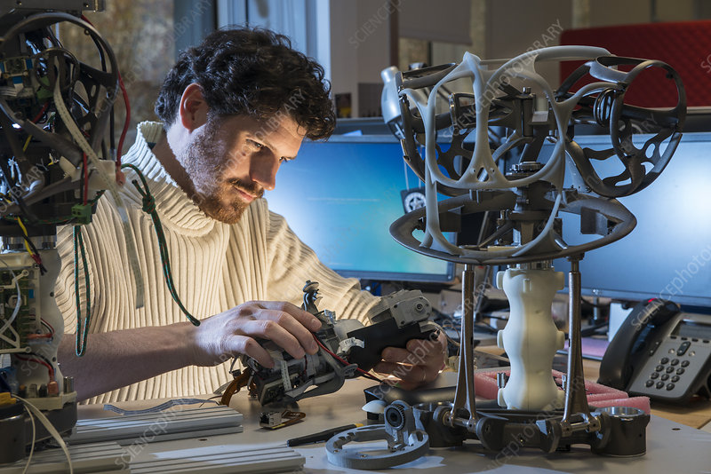 Engineer working on Romeo robot thorax