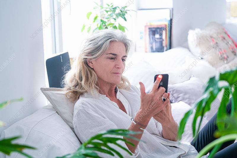 Senior woman using health app