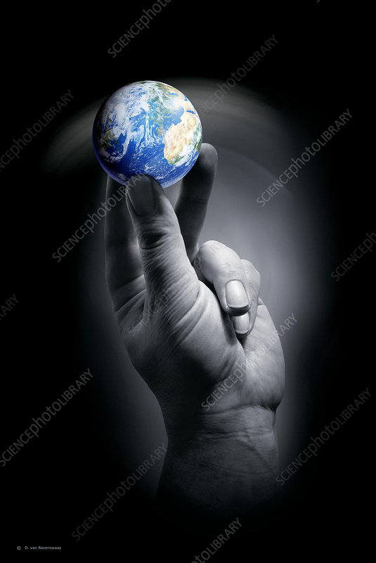 The Earth held by a human hand
