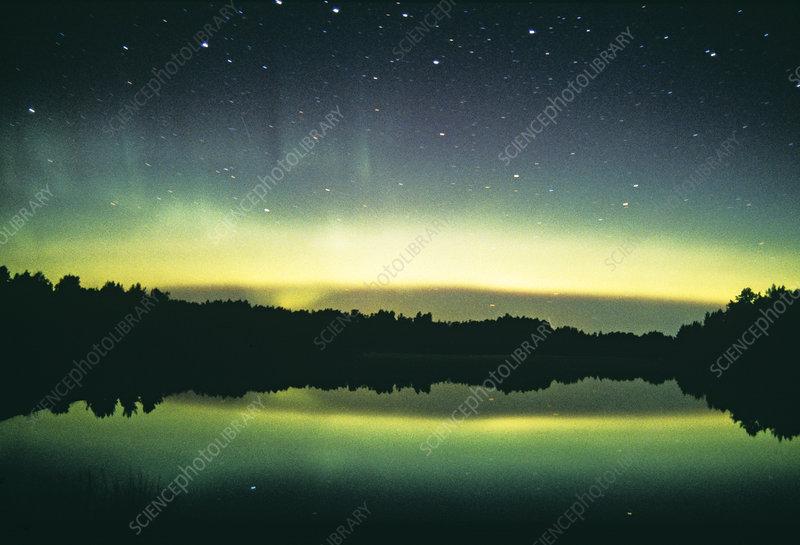 Aurora borealis display reflected upon water