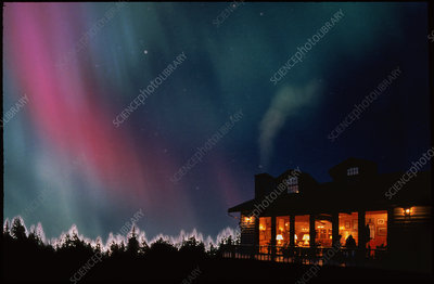 Aurora borealis or northern lights over a home