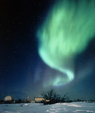 Aurora Borealis and satellite station in