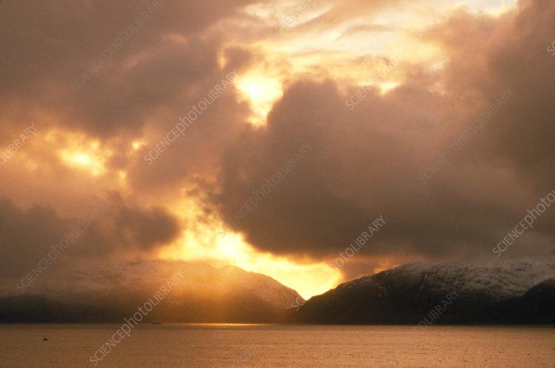 Cumulus clouds above a Scottish loch.