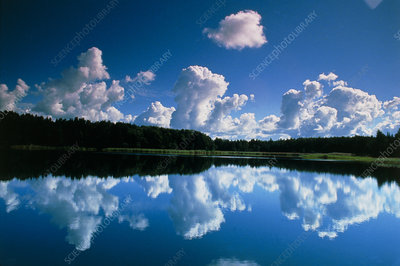 Cloud formation reflected in lake