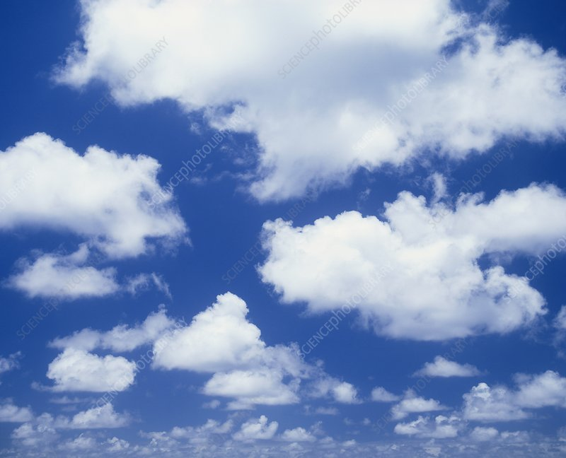 Cumulus clouds against a blue sky