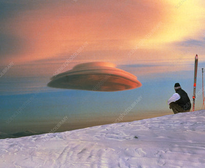 Skier looks at a lenticular cloud