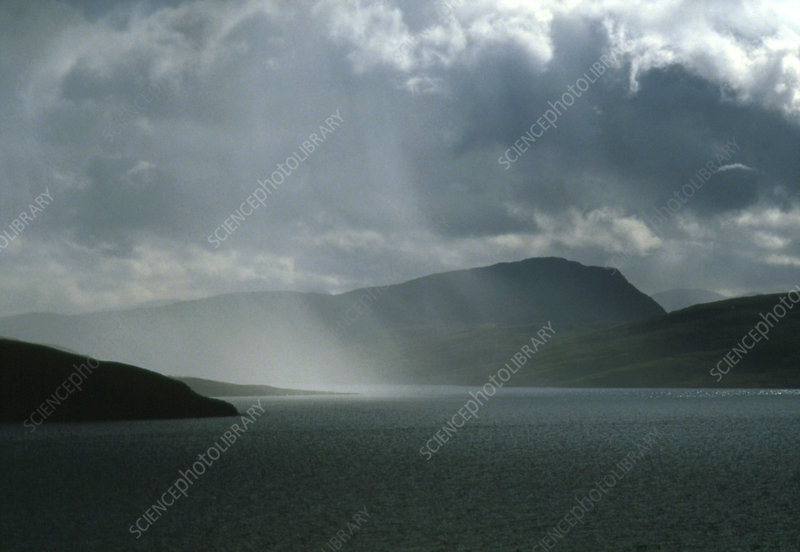 Rain squall blowing over Higland region, Scotland
