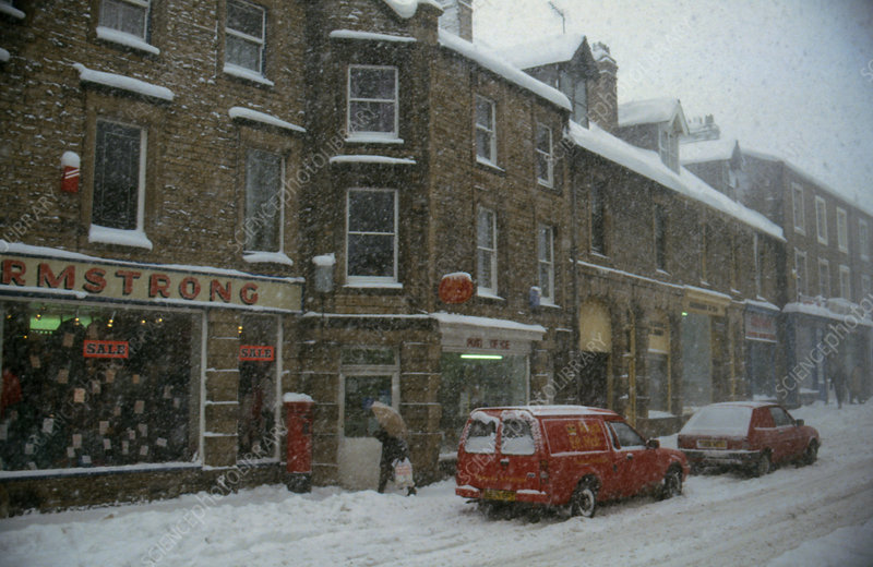 Blizzard scene in English town high street