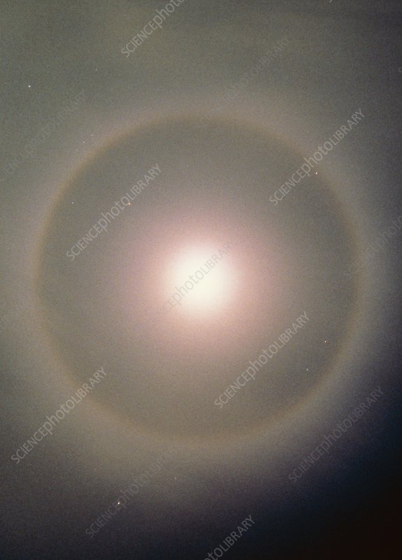 Cirrus cloud creates a halo around the Moon.