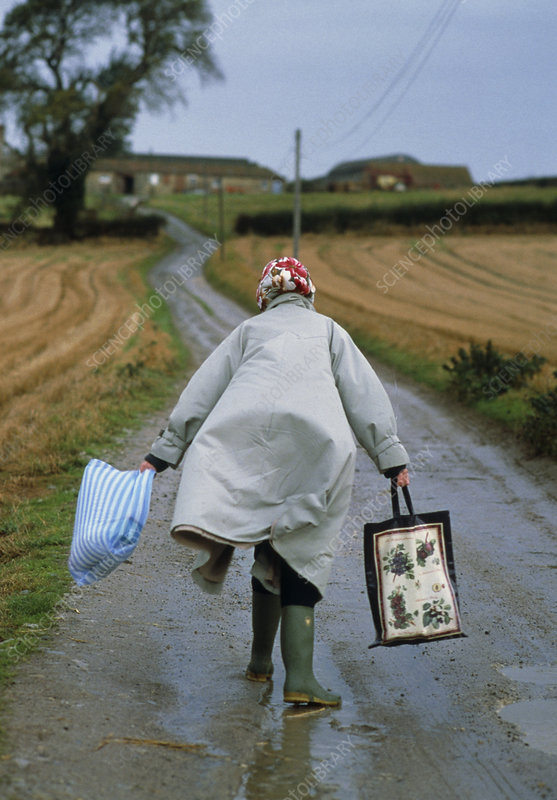 View of an elderly woman caught in storm