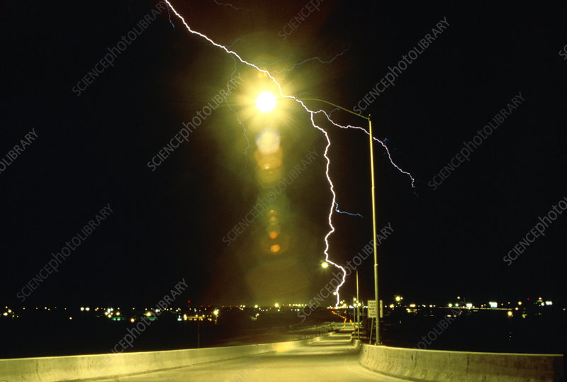 Lightning bolt behind street light