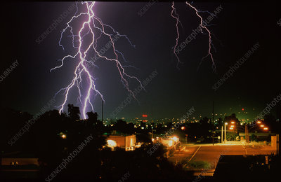 Lightning strike at night over a city