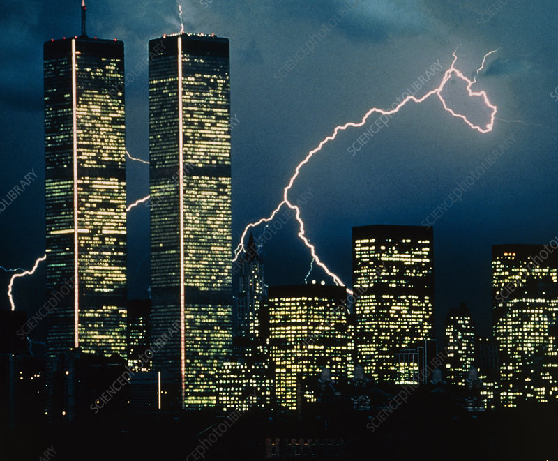 Lightning bolts striking behind skyscrapers