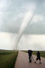Storm chasers videoing a tornado