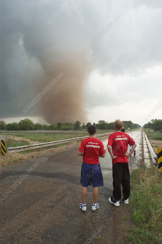 Stormchasers watching a tornado