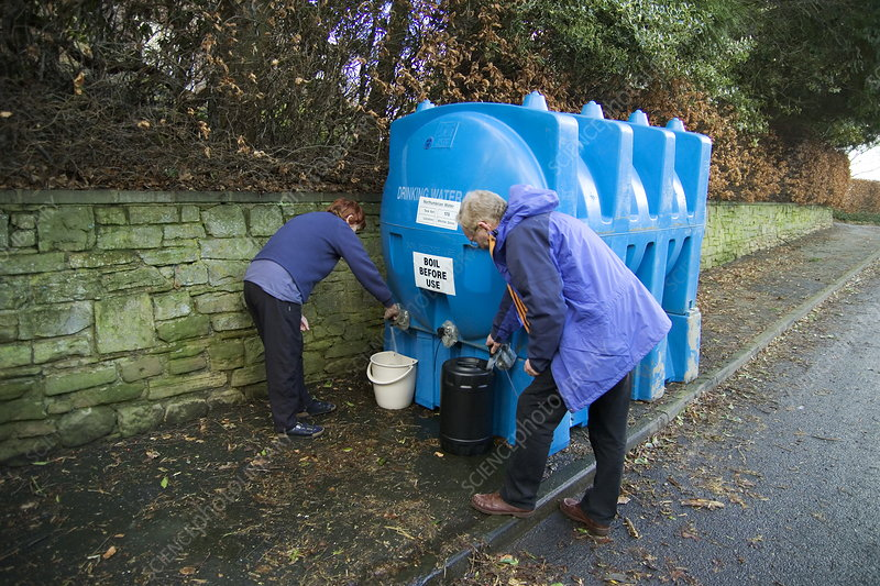 Resident collecting water, Hexham