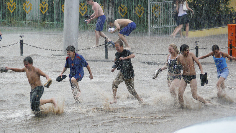 Teenagers playing in floodwaters