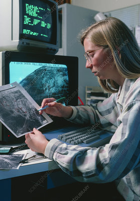 Meteorologist studying satellite imagery