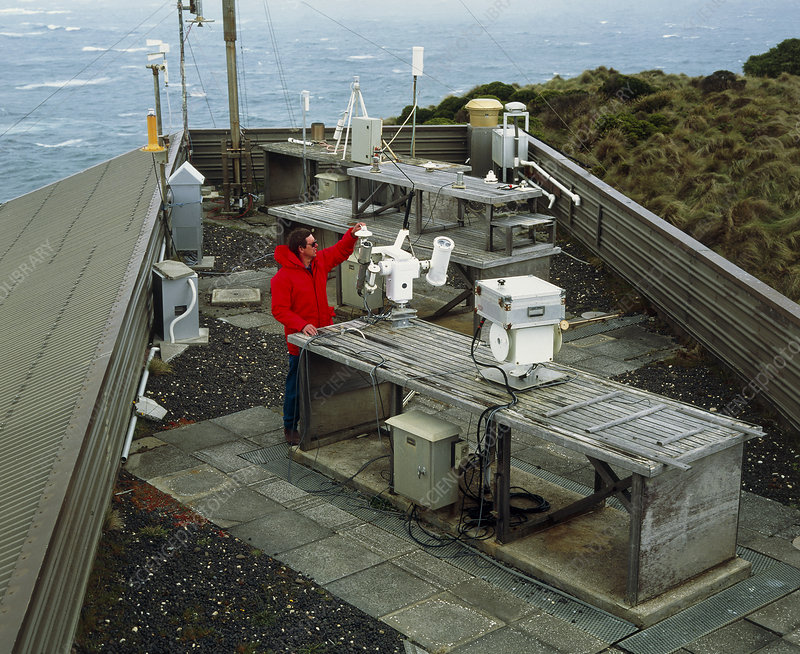Scientist on the roof of a meterological station